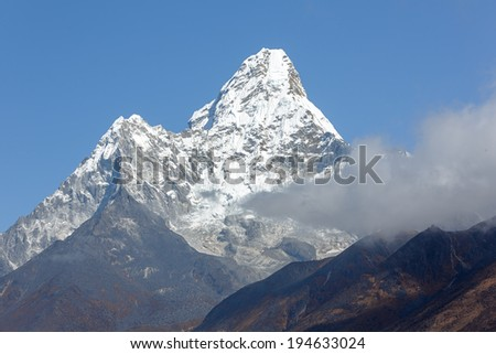 Ama Dablam (6812 m) in the first light of the Sun (view from Phortse to Periche trek) - Everest region, Nepal, Himalayas - stock photo