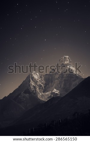 Ama Dablam (6,856 m) in the fullmoon light. Nepal, Everest region, view from Tengboche (3,860 m) to Ama Dablam (6,856 m) - stock photo