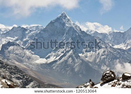 Ama Dablam peak - view from Cho La pass, Sagarmatha National park, Everest region, Eastern Nepal. Ama Dablam (6858 m) is one of the most spectacular mountains in the world and a true alpinists dream - stock photo