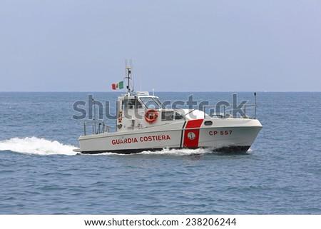 AMALFI COAST, ITALY - JUNE 28: Guardia Costiera in Amalfi Coast on JUNE 28, 2014. Coast Guard boat patroling at Tyrrhenian sea in Amalfi Coast, Italy. - stock photo