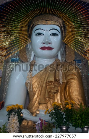 AMARAPURA,MYANMAR-JULY 1 : Sitting Buddha image in Shwe Kyat Yat Pagoda is important and large Buddha on July 1,2014 in Amarapura city,Middle of Myanmar.