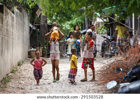 AMARAPURA, MYANMAR - JUNE 26 2015: Street life at the start of monsoon season in Amarapura on the outskirts of Mandalay city in Myanmar (Burma) - stock photo