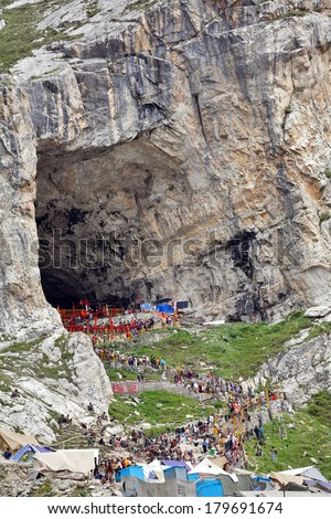 AMARNATH, JAMMU & KASHMIR, INDIA - JULY 18, 2006: Holy Amarnath Cave in Kashmir Himalays. It is a Hindu shrine dedicated to Shiva.  It is considered to be one of the holiest shrines in Hinduism.  - stock photo