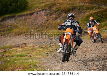 amateur motocross drivers have hobby ride on mountains road - stock photo