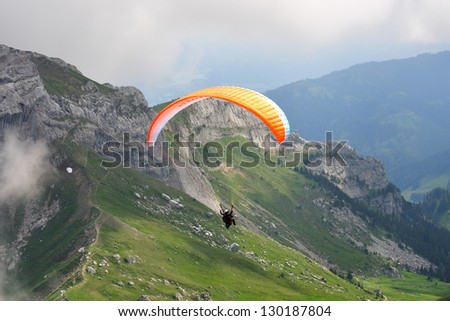 Amateur paraglider with the instructor at Pilatus mountain near Lucern, Switzerland - stock photo