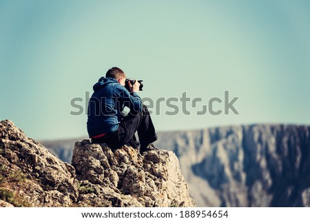 Amateur photographer with digital camera. - stock photo