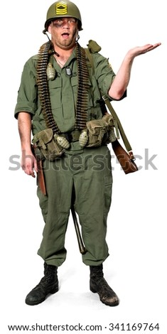 Amazed Caucasian man in uniform holding invisible object - Isolated