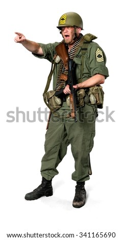 Amazed Caucasian man in uniform holding machine gun - Isolated