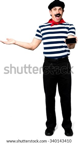 Amazed Caucasian man with short black hair in costume holding mobile phone - Isolated - stock photo