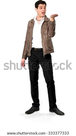 Amazed Caucasian man with short dark brown hair in casual outfit holding invisible object - Isolated