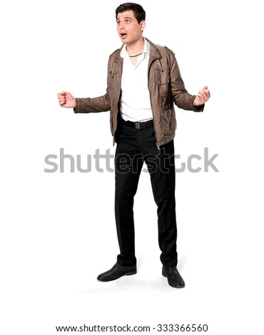 Amazed Caucasian man with short dark brown hair in casual outfit with arms open - Isolated - stock photo