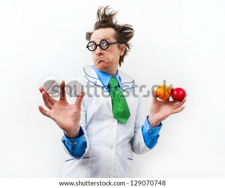 Amazed doctor with tablet and fruit in hand - stock photo