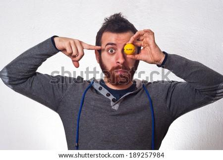 Amazed expressive man point at range golf ball - stock photo