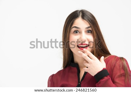 Amazed face close up shot of youn gorgeous girl in red dress - stock photo