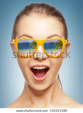 amazed girl in shades with beach reflection