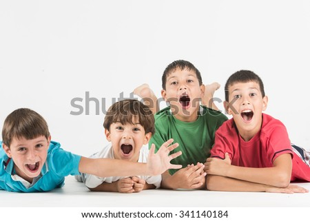 Amazed group of children posing together  - stock photo