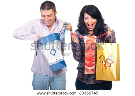 Amazed happy couple of what they bought looking in their shopping bags isolated on white background - stock photo
