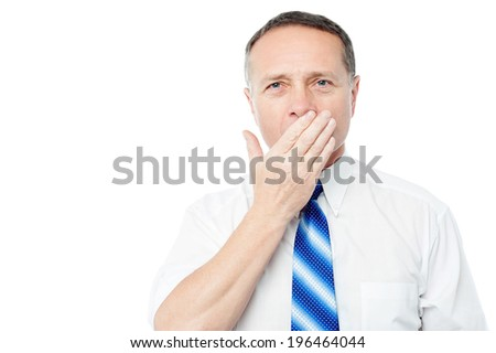 Amazed man covering his mouth - stock photo