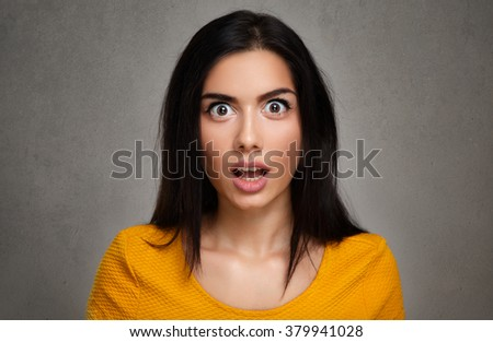 amazed surprised young woman - stock photo