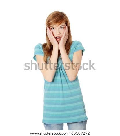 Amazed teen female isolated on white background - stock photo
