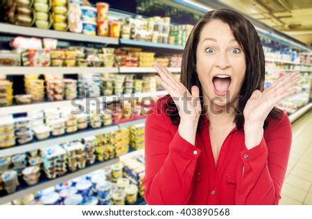 Amazed women at supermarket shopping mall store - stock photo