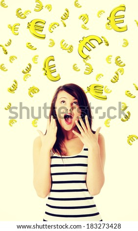 Amazed young caucasian woman looking on falling down euros. Winning in lottery concept. Isolated on white background. - stock photo
