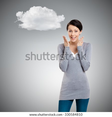Amazed young girl, isolated on grey background - stock photo