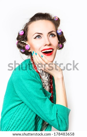 Amazement - beauty woman excited looking to the side. Surprised happy young woman looking sideways in excitement - stock photo