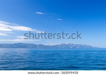 Amazing adriatic sea with mountains on Peljesac peninsula in the background - stock photo