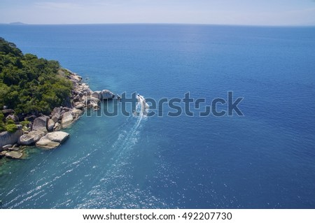 amazing aerial view sea and speed boat with vibrant blue at perhentian island, malaysia
