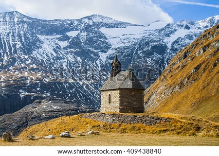 Amazing Alpine landscape. Sunrise, temple  in the mountains. - stock photo