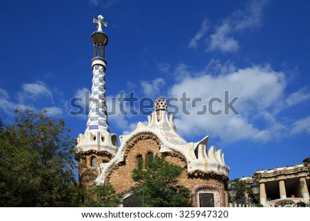Amazing architecture, and use of mosaic tiles and stone in Park Guell, Barcelona, Spain. - stock photo