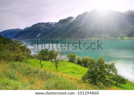 amazing arctic glacier river in mountains - stock photo