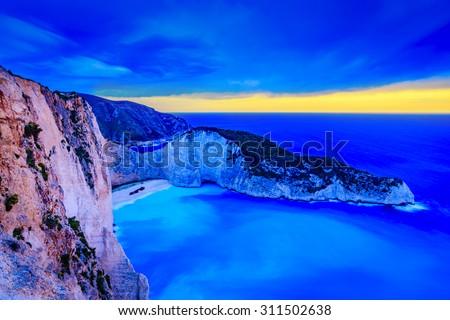 Amazing beach Navagio bay at dusk, Zakynthos, Greece - stock photo