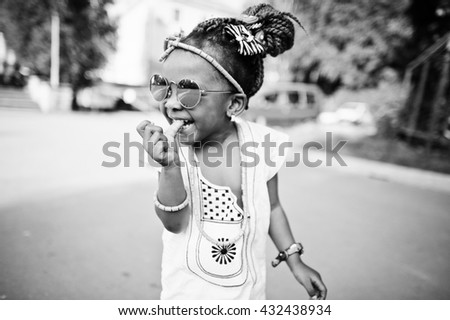 Amazing beautiful african american baby girl with sunglasses having fun - stock photo