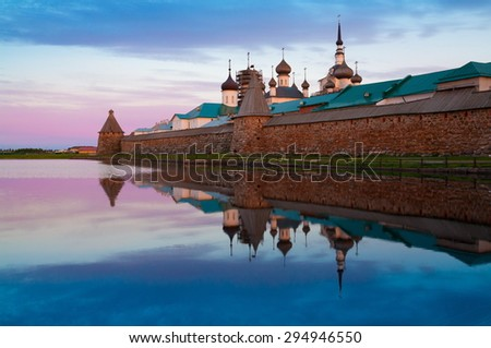 amazing beautiful landscape old historical orthodox island Solovki unique dome church monastery north country russia white sea lake water sunset  UNESCO world heritage  - stock photo