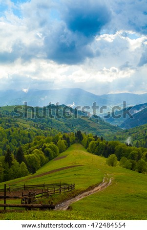 Amazing beautiful mountains with dramatical sky and clouds. View from mountain.