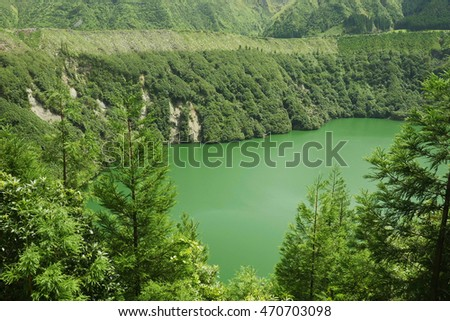 amazing beautiful view between tree forest of Sete Cidades lake or lagoon of Santiago in Sao Miguel Azores island of Portugal in Europe holiday travel destination