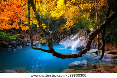 Amazing beauty of Asian nature. Tropical waterfall flows through dense jungle forest and falls into wild pond  - stock photo