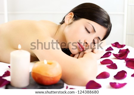 Amazing beauty relax in spa with candles and roses during vacation in beauty farm - stock photo