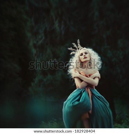 Amazing blonde woman in spirit garden. fairy tale fashion. grain added - stock photo