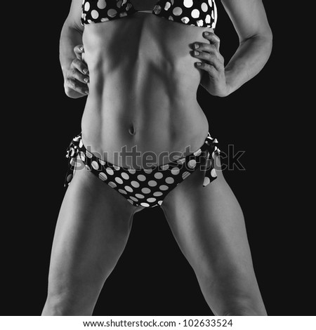 Amazing body in a polka dot bikini in black and white - stock photo