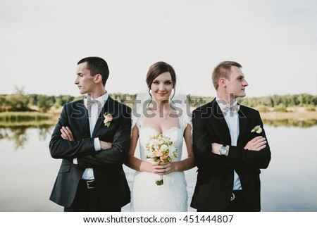 amazing  bride photographed with beautiful males