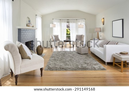 Amazing bright and harmonic Living Room Interior with white couch, chair, fire place, beautiful inlaid hardwood floor, arched niches and grey handwoven rug. - stock photo