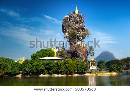Amazing Buddhist Kyauk Kalap Pagoda under blue sky. Hpa-An, Myanmar (Burma) travel landscapes and destinations