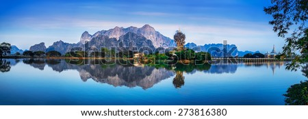 Amazing Buddhist Kyauk Kalap Pagoda under evening sky. Hpa-An, Myanmar (Burma) travel landscapes and destinations. Five images panorama - stock photo