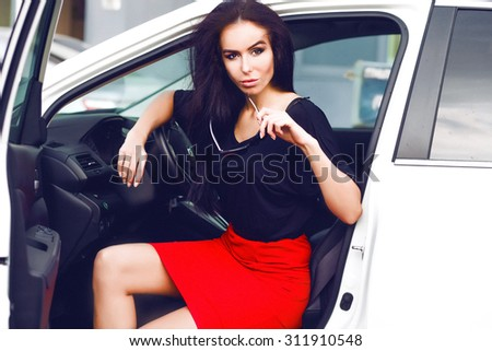 Amazing close-up Portrait sensual luxury woman on meeting,Business woman,luxury accessories,natural makeup sitting in luxury white car.Attractive woman wear long skirt,hat,elegant style,fashionable - stock photo