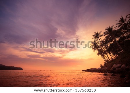Amazing colors of tropical sunset. Phuket island, Thailand travel landscapes and destinations - stock photo