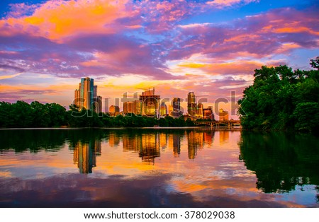 Amazing Dramatic Austin Texas Sunset Mirror Image Town Lake Reflection with an amazing colorful cloud display reflecting on the almost glass like colorado river ATX 2015 - stock photo