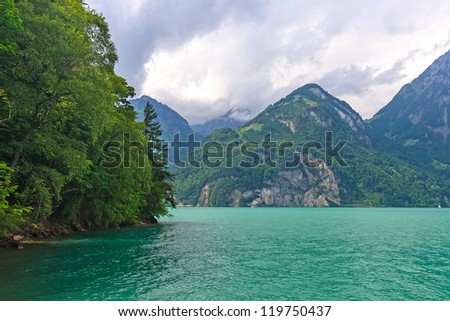 Amazing emerald green Vierwaldstatter lake (vierwaldstattersee) near Luzern city, Switzerland